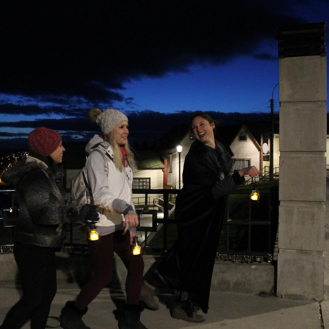 A small group departing on their nocturnal ghost tour at the Mirador Cerro de la Cruz, Punta Arenas