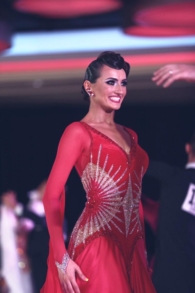 Liliia Bieliei at dance competition in Glow Earrings