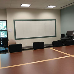 Grace Hauenstein Library Meeting Room 302 with Chairs and White Board
