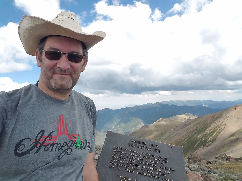 Dr. Florian Birkmayer, MD in his Homegrown t-shirt on top of Wheeler Peak in Taos for a weekend stroll in the forest.
