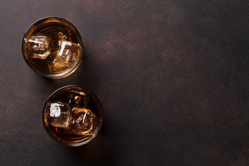 Whiskey with ice. Top view with copy spa