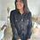 Thumbnail: Salopette en daim noir ceinturée et boutonnée