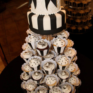black and white cake with cupcakes.jpg
