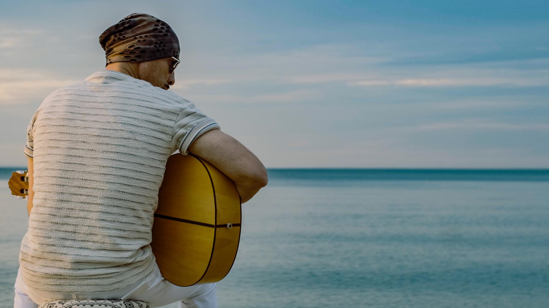 Guitar and Sea Back Facing Camera