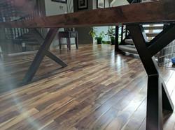 Live edge Clara Walnut table with metal legs on Acacia flooring