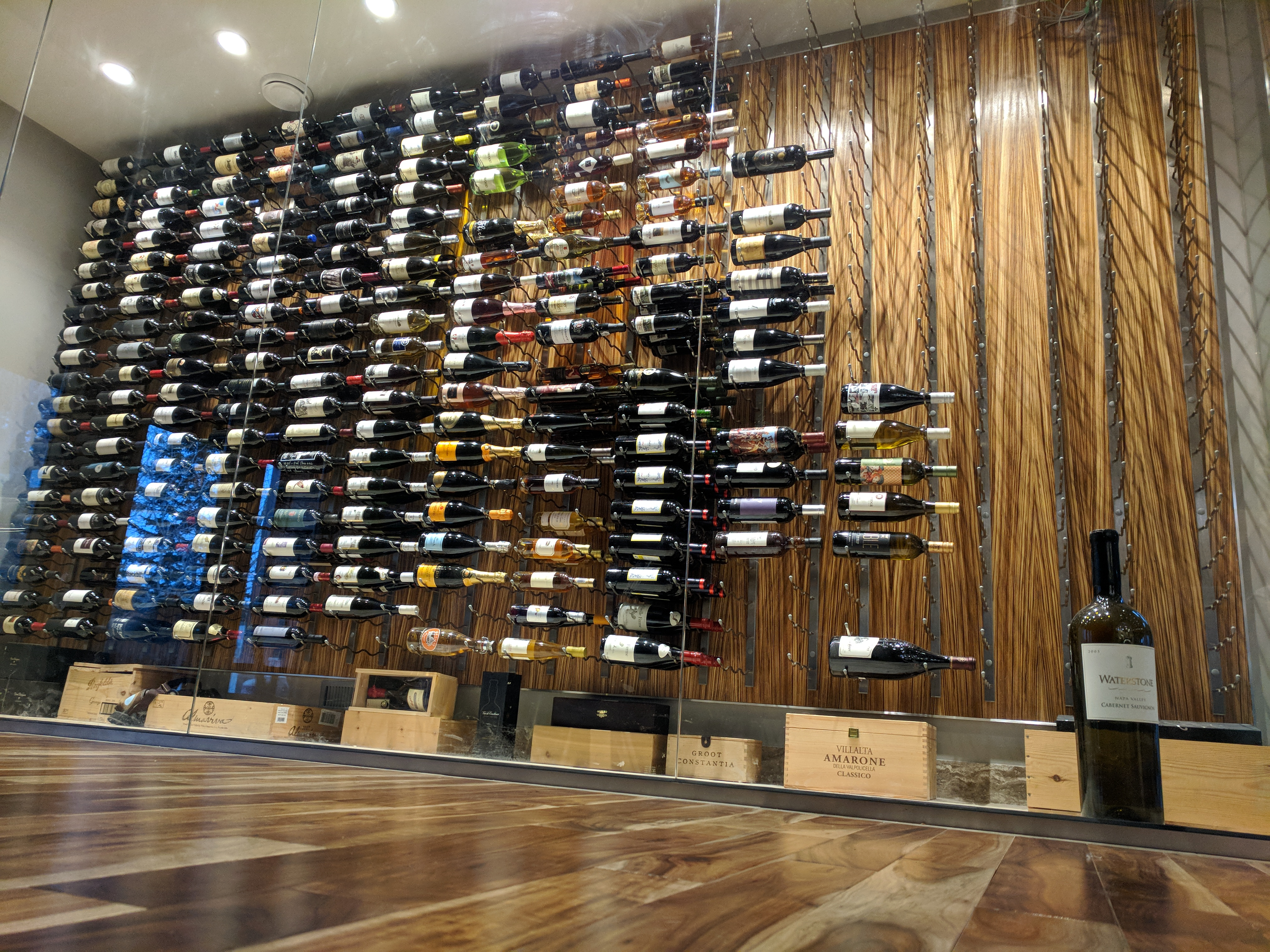 Zebra wood wine display room with glass walls