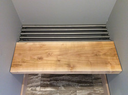 Custom Cherry wood bench with stainless steel mounting and step out feature