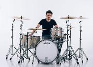 Man sat at a white drumkit