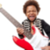 Boy dressed as Jimi Hendrix playing guitar Barnsley Music Hub