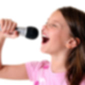 Girl singing into a microphone Barnsley Music Hub