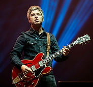 Noel Gallagher playing guitar