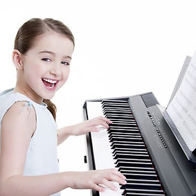 Girl playing piano Barnsley Music Hub