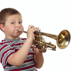 Boy playing a trumpet Barnsley Music Hub