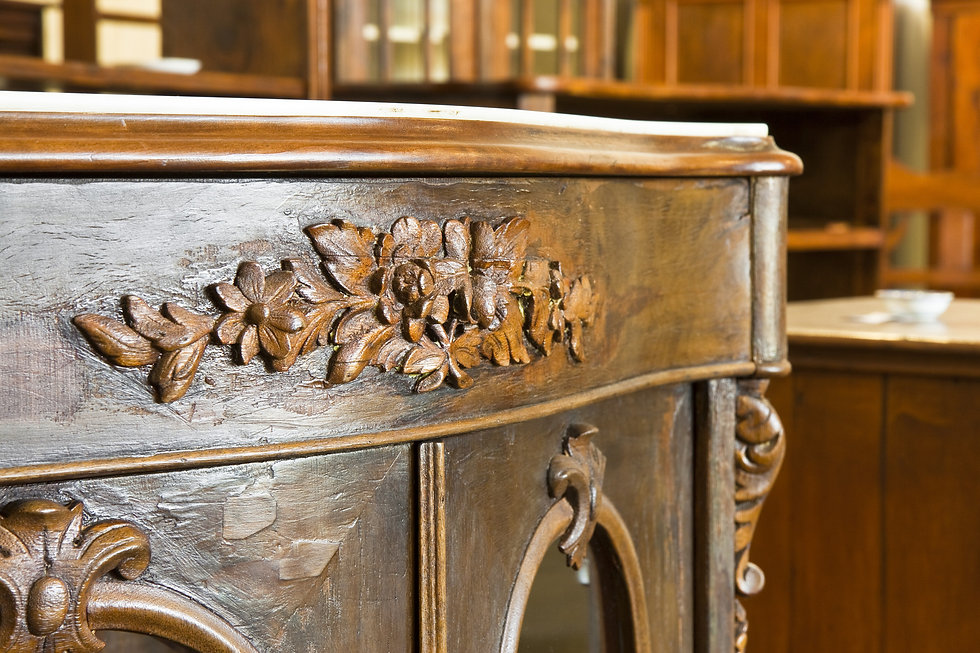 close-up of wooden carving on wooden cabinet