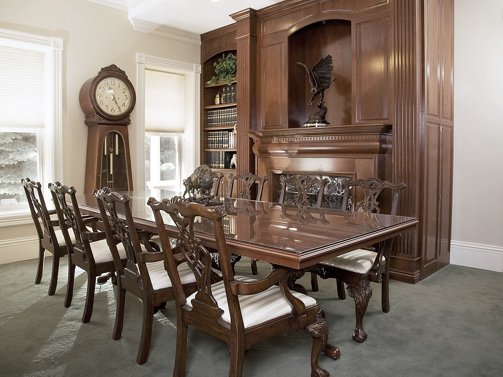 Antique dining table, dining chairs, bookcase, and grandfather clock