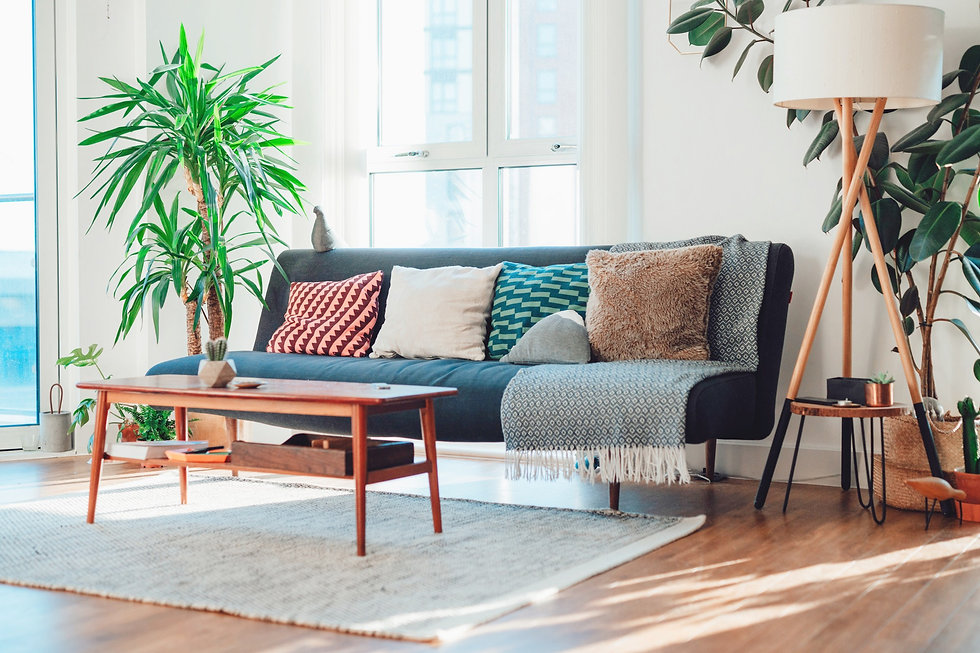 Modern lounge infused with retro feels thanks to vintage coffee table and lamp