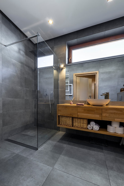 Modern shower and fully tiled bathroom