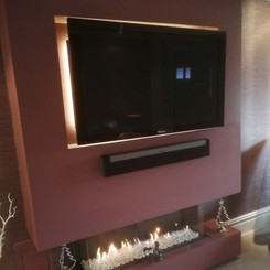 striking built-in fire within feature wall