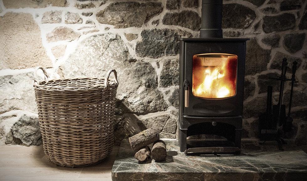 wood-burning stove on rustic brick hearth