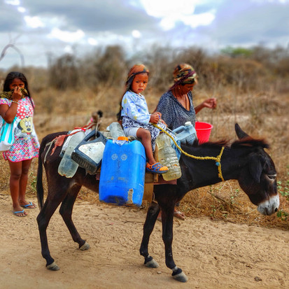 Woman and Child carrying water