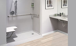 Open concept, accessible shower with seating and hand rails
