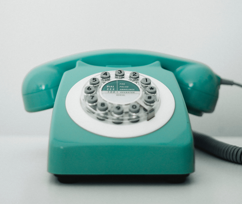 Teal rotary style telephone