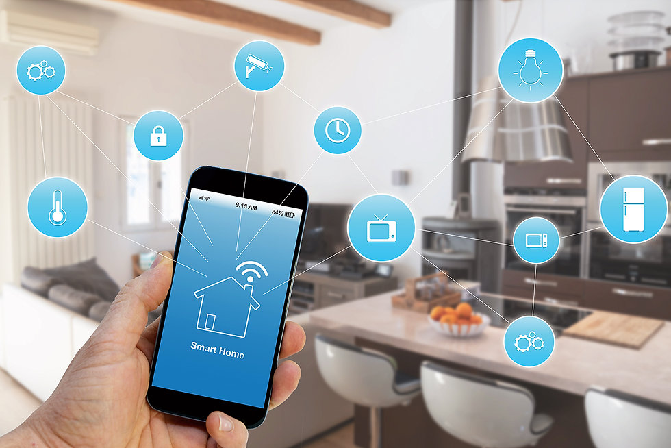 Kitchen in the background with a person holding their smart phone with a smart home app