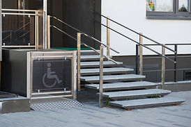 Office entryway equipped with wheelchair accessibility lift.