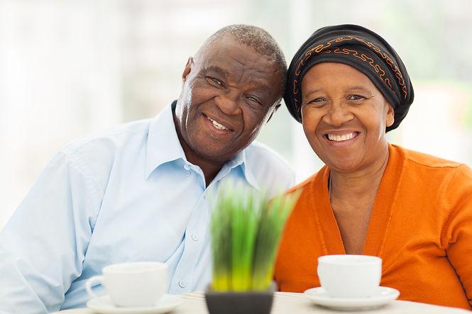 cute senior african couple portrait at h