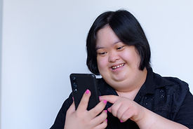 Close-up of a girl with a disability using her smart phone