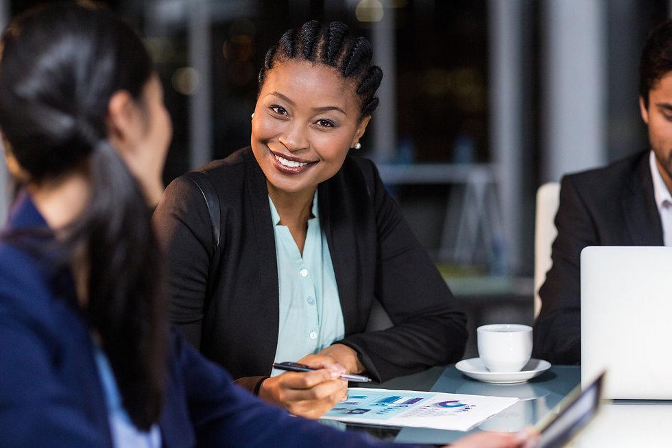 Portrait of businesswoman interacting wi