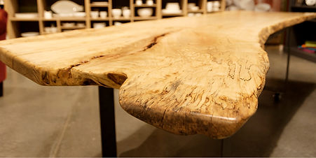 Custom sliced wood table created for a showroom by Poss Productions