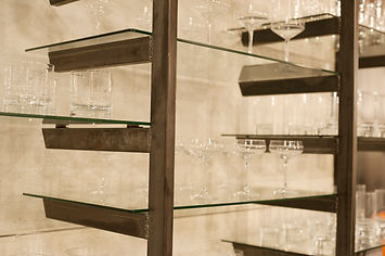 Custom metal shelving designed by Poss Productions
