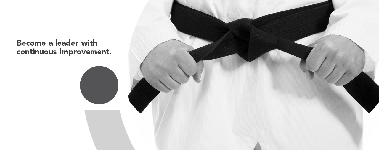 Person in karate outfit tightening their black belt