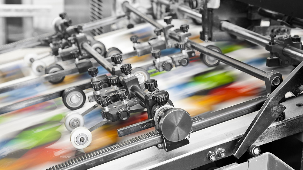 industrial printer printing many colors on paper