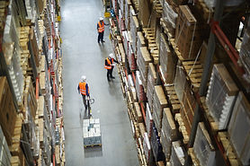 workers pulling inventory from a warehouse shelf