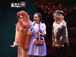 The Cowardly Lion, Dorothy, and the Scarecrow