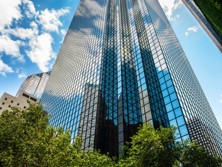Woods Capital Assumes Management of Thanksgiving Tower