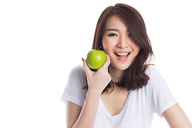 Young beautiful asian woman holding a green apple on white background.jpg