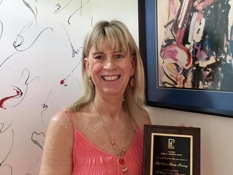 Barbara Receives Plaque for Winning the 2020 Poetry Is Life Book Award
