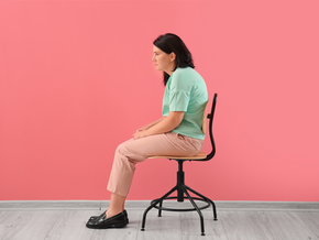 How does sitting impact posture?