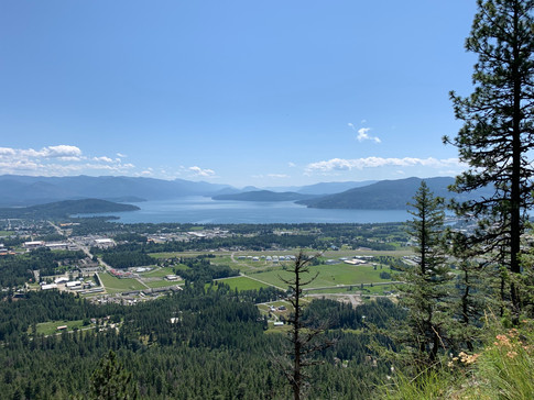 View of Sandpoint with Lake Pend Oreille the background from the top of Mickinnick Trail during a training hike.