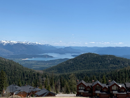 Snowcapped mountains on a early-season training ride to Schweitzer Mountain resort.