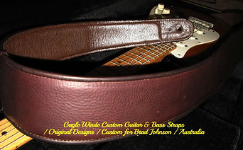 Custom solid color bass guitar strap w/leather trim & lining. Completely handcrafted & personalized to the musicians playing style. Online custom orders & online store orders available at gaylewinde.com