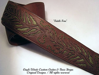 """Fiddle Fern"" A handcrafted custom guitar strap with an intricate inlay. Red-brown oil tanned leather strap w/moss green suede fronds & tendrils. Fully padded & leather lined. An artisan original design - gaylewinde.com"