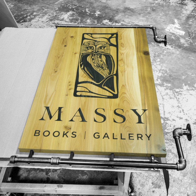 Massy Projecting Sign