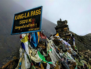 Mist and prayer flags cloaking the Kang