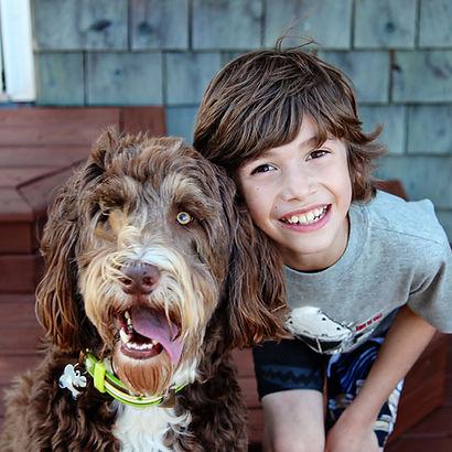 bigstock-Young-boy-with-Pet-Dog-closeup-