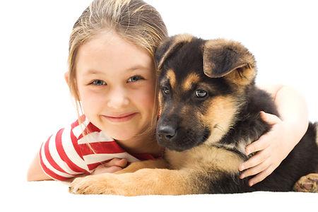 bigstock-Girl-Embraces-A-Puppy-89005079.