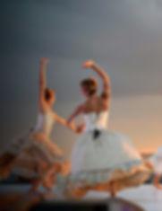 5-women-in-white-dress-dancing-under-gra